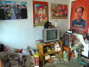 Mao and other figures, political and traditional, remain present across rural China, often gracing parlors like this one.