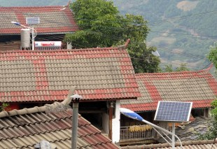 Government programs have brought new roofs and solar lights and water heaters to communities with activist leaders.